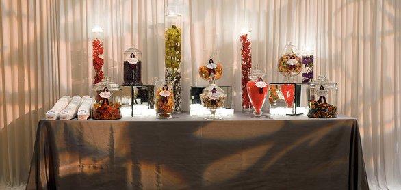 "<a href=""http://www.flowerfirm.com"">The Flower Firm</a><em>170 N Racine</em>"