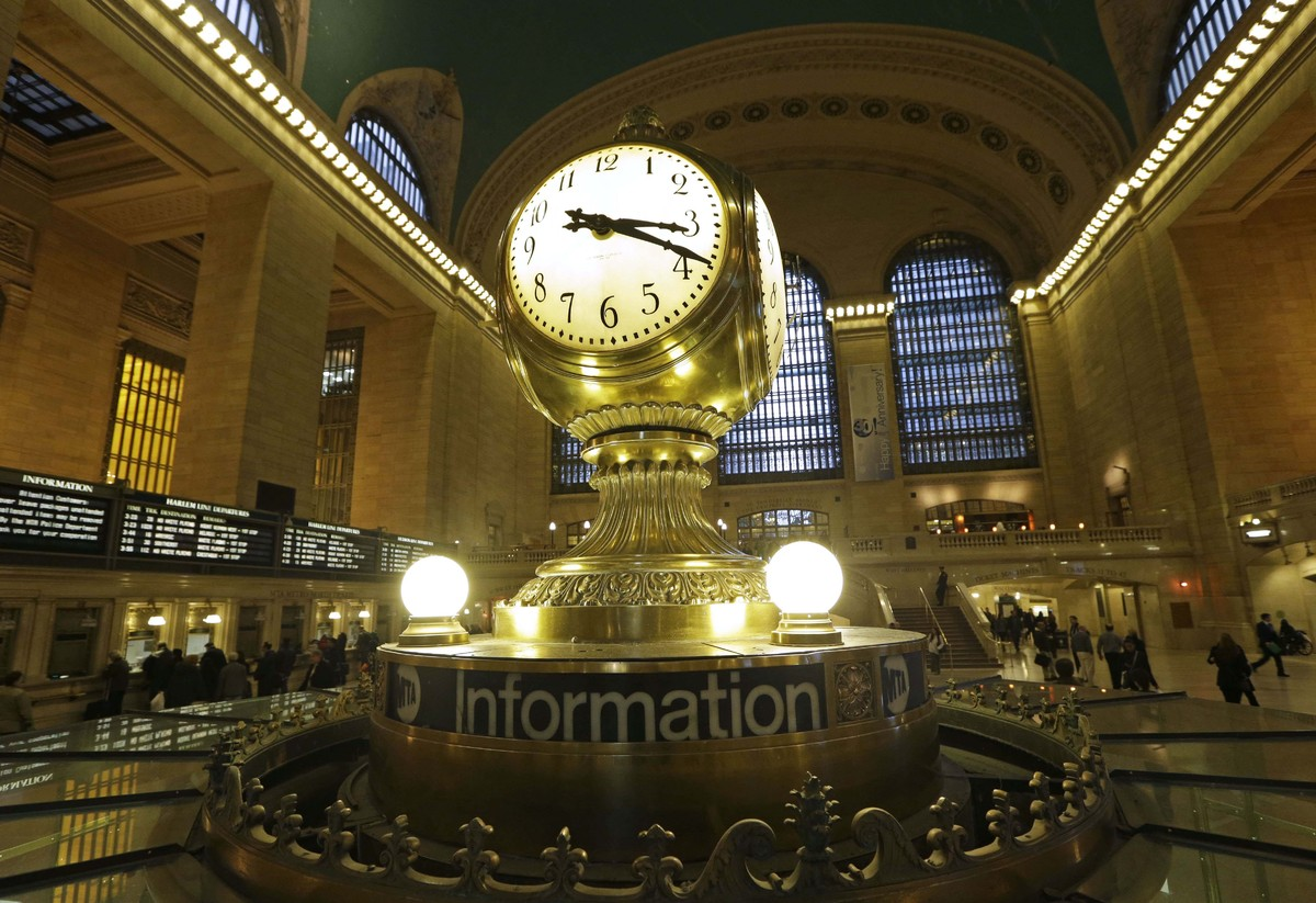 FILE- In this Jan. 9, 2013 file photo, the famous opalescent clock keeps time at the center of the main concourse in Grand Ce
