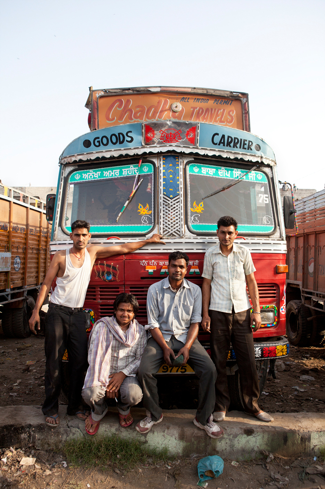 Along the highway, one unmistakable feature is the brightly decorated trucks that ply the country's roads. The men who drive
