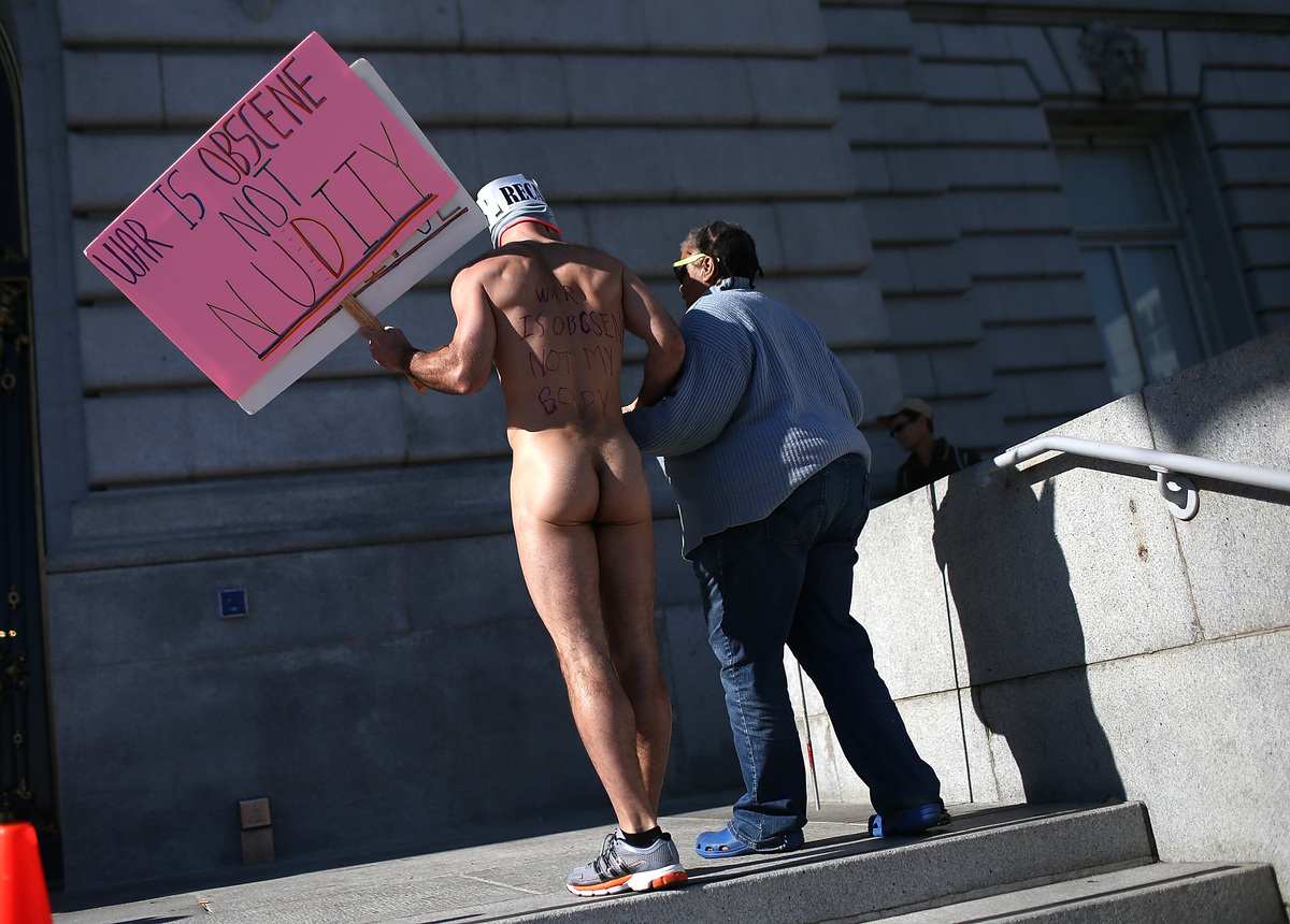 SAN FRANCISCO, CA - FEBRUARY 01:  (EDITORS NOTE: Image contains nudity)  Nude activist Trey Allen helps a blind woman up stai