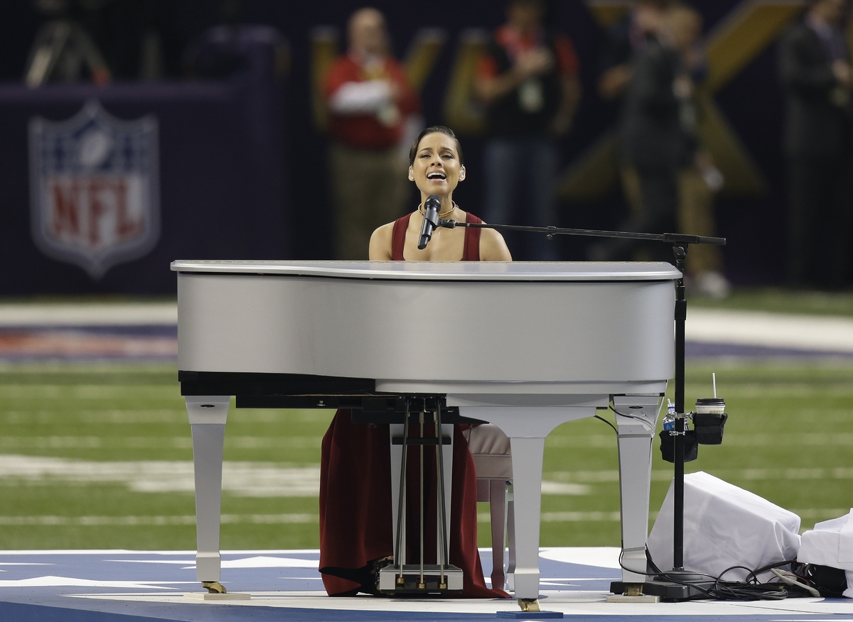 Alicia Keys sings the national anthem before the NFL Super Bowl XLVII football game between the San Francisco 49ers and the B