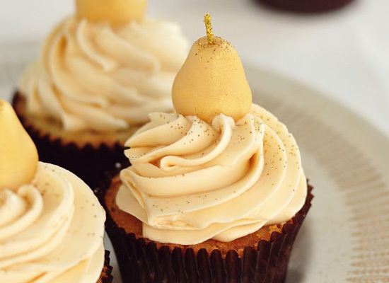 "<strong>Get the <a href=""http://sweetapolita.com/2011/10/marzipan-pear-cupcakes-with-caramel-buttercream/"">Marzipan & Pear Cu"
