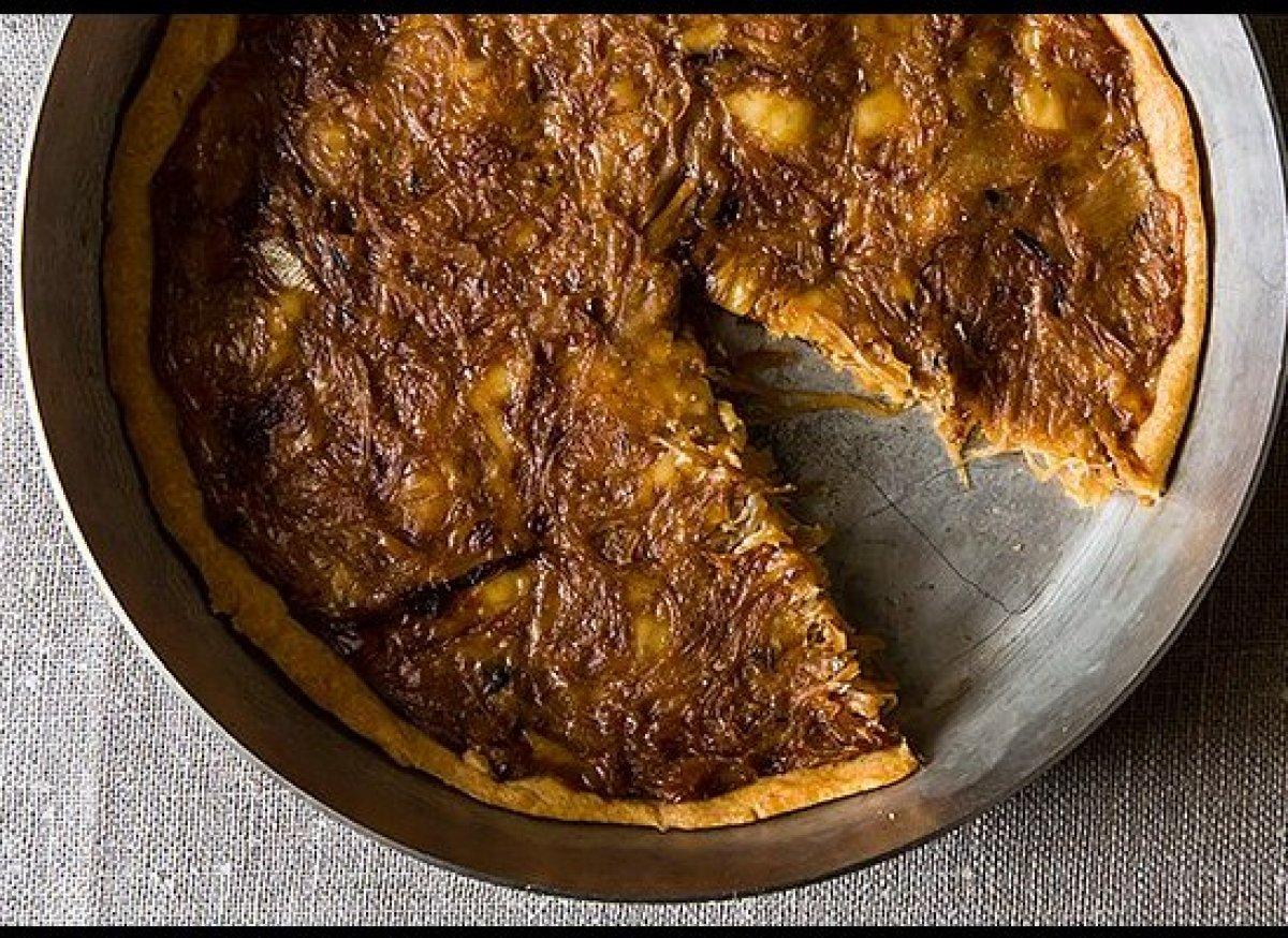 "<em><strong><a href=""http://food52.com/recipes/10177-french-onion-tart"" target=""_hplink"">Get the recipe</a></strong>.</em><br"