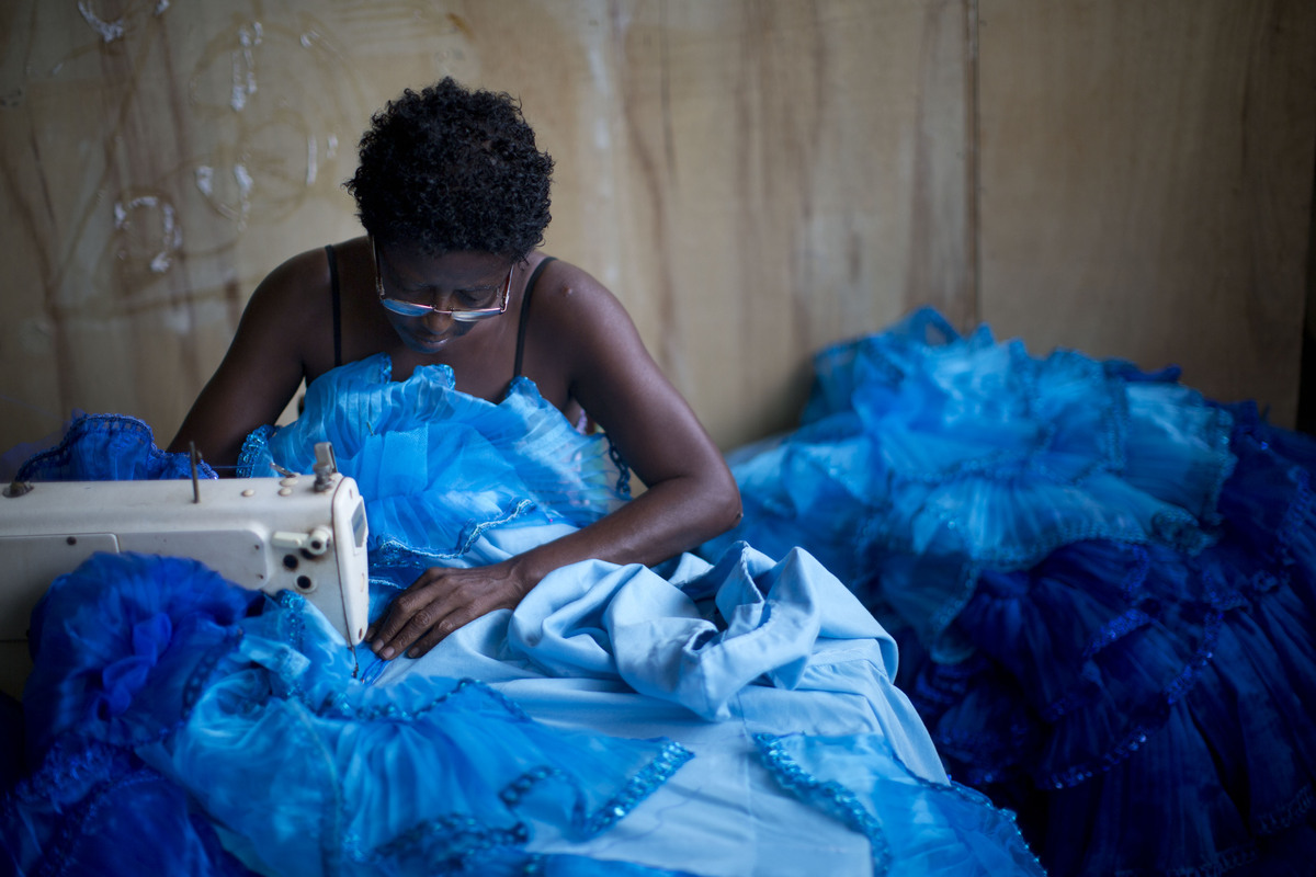 A seamtress sews a costume for the Inocentes de Belford Roxo samba school, in Rio de Janeiro, Brazil, Wednesday, Jan. 16, 201
