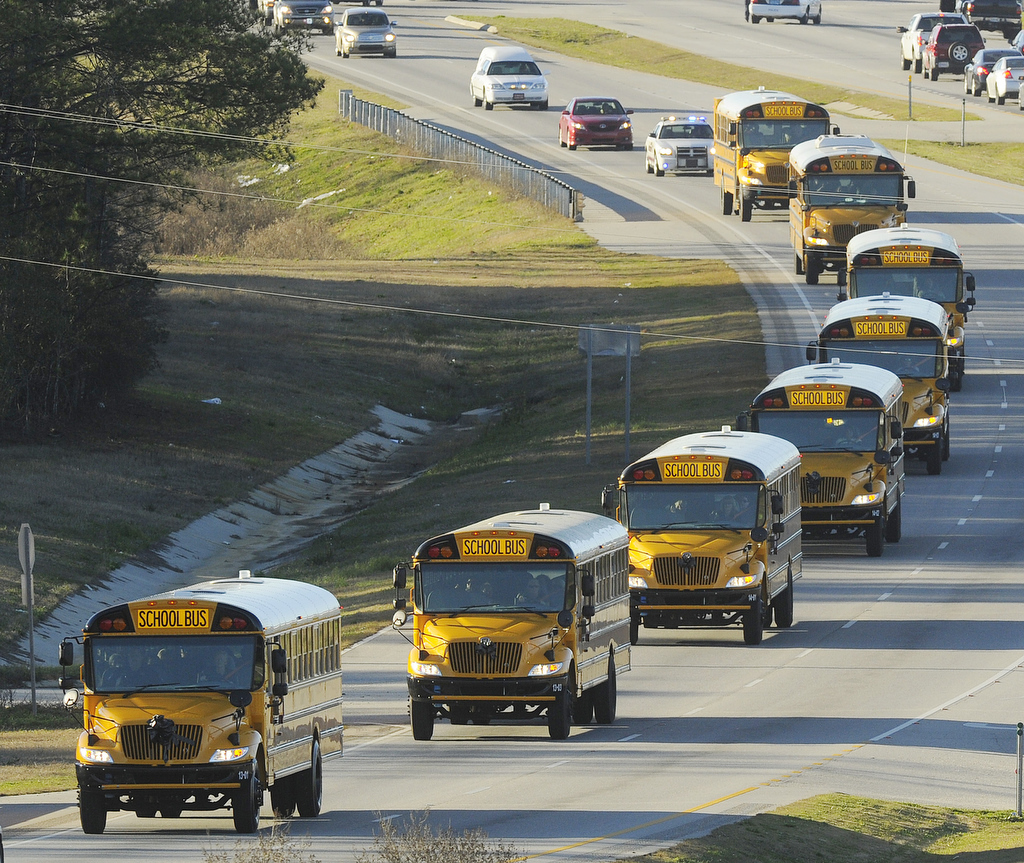 "The funeral procession of slain bus driver Charles ""Chuck"" Poland makes its way down Highway 231 in Ozark, Ala., Sunday Over"