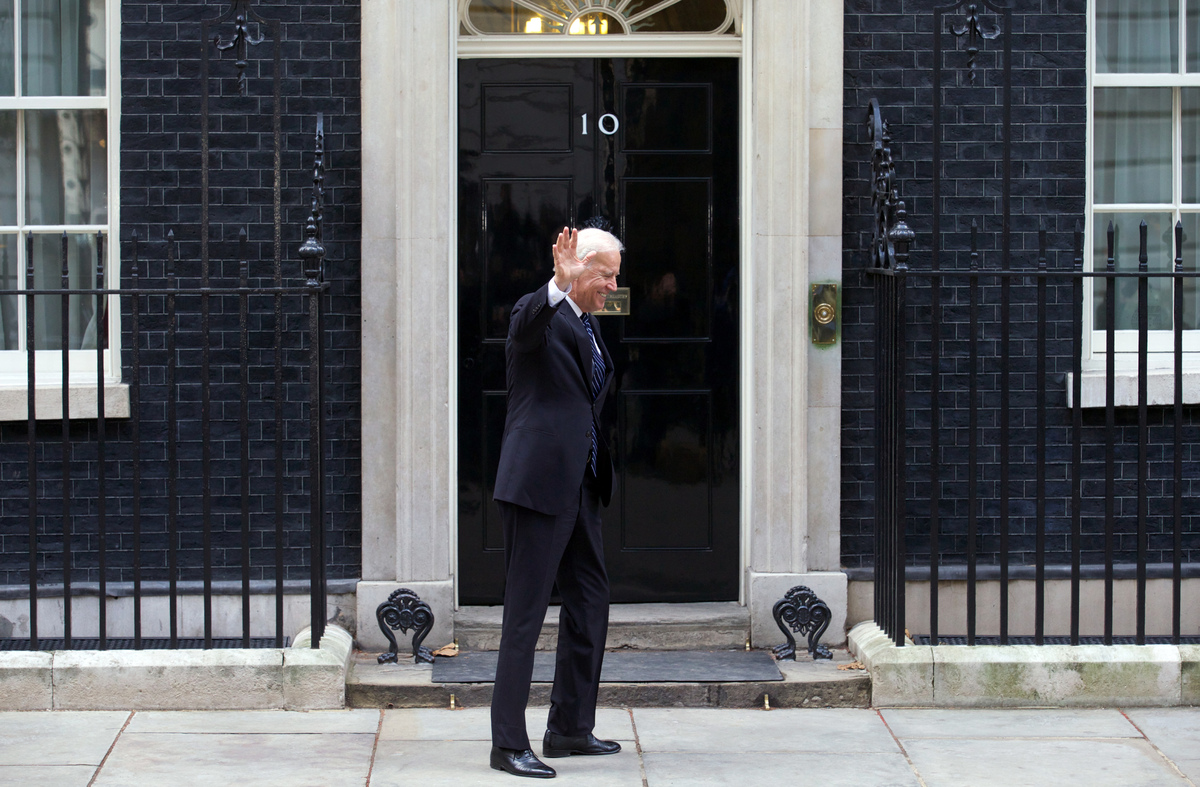US Vice President Joe Biden waves to the press as he arrives at Downing Street in London on February 5, 2013 for meetings wit