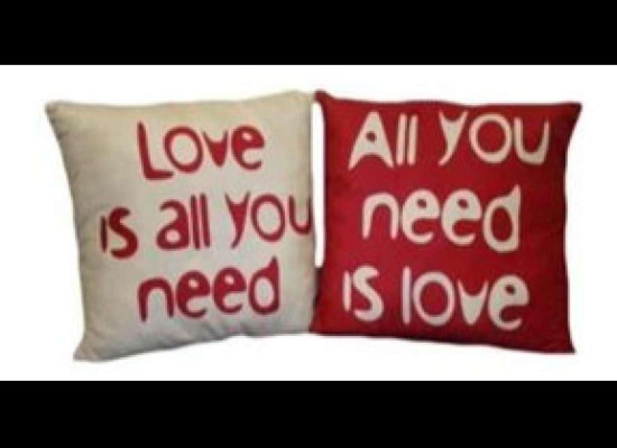 """Home decor-loving darlings will love the """"All You Need Is Love"""" Reversible Pillows (set of two) inspired by The Beatles' hit"""