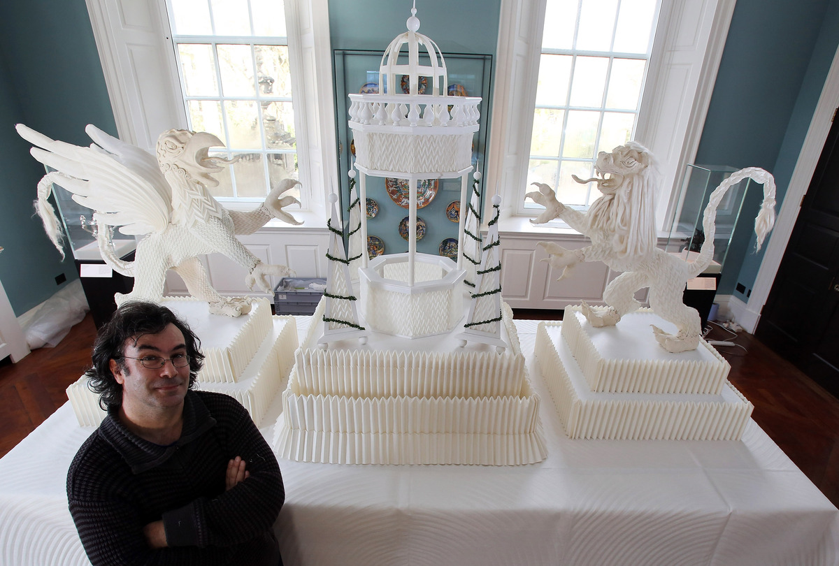 Artist Joan Sallas stands beside a 1.5 metre high folded linen table fountain he is displaying as part of a new exhibition 'F
