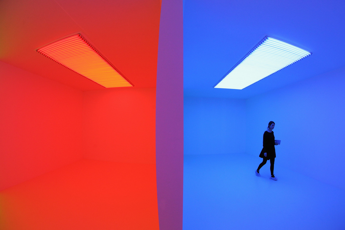 A woman admires an art installation by Carlos Cruz-Diez entitled 'Chromosaturation' which features in the Hayward Gallery's e