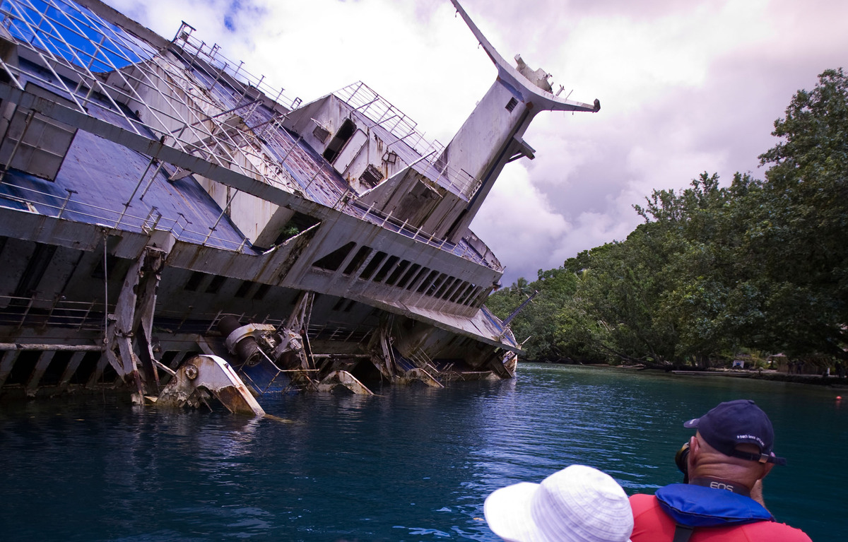 Tourists visit the wreck of the World Discoverer.