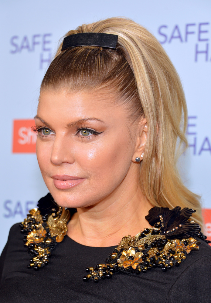 We dig this retro '50 beehive style. Fergie's hair is full of secrets for sure.