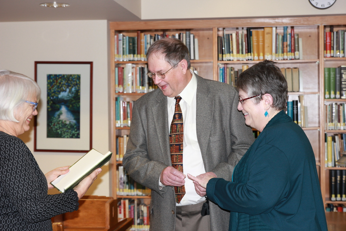 Children's librarian Theresa Gemmer officiates Barbara and David's wedding.