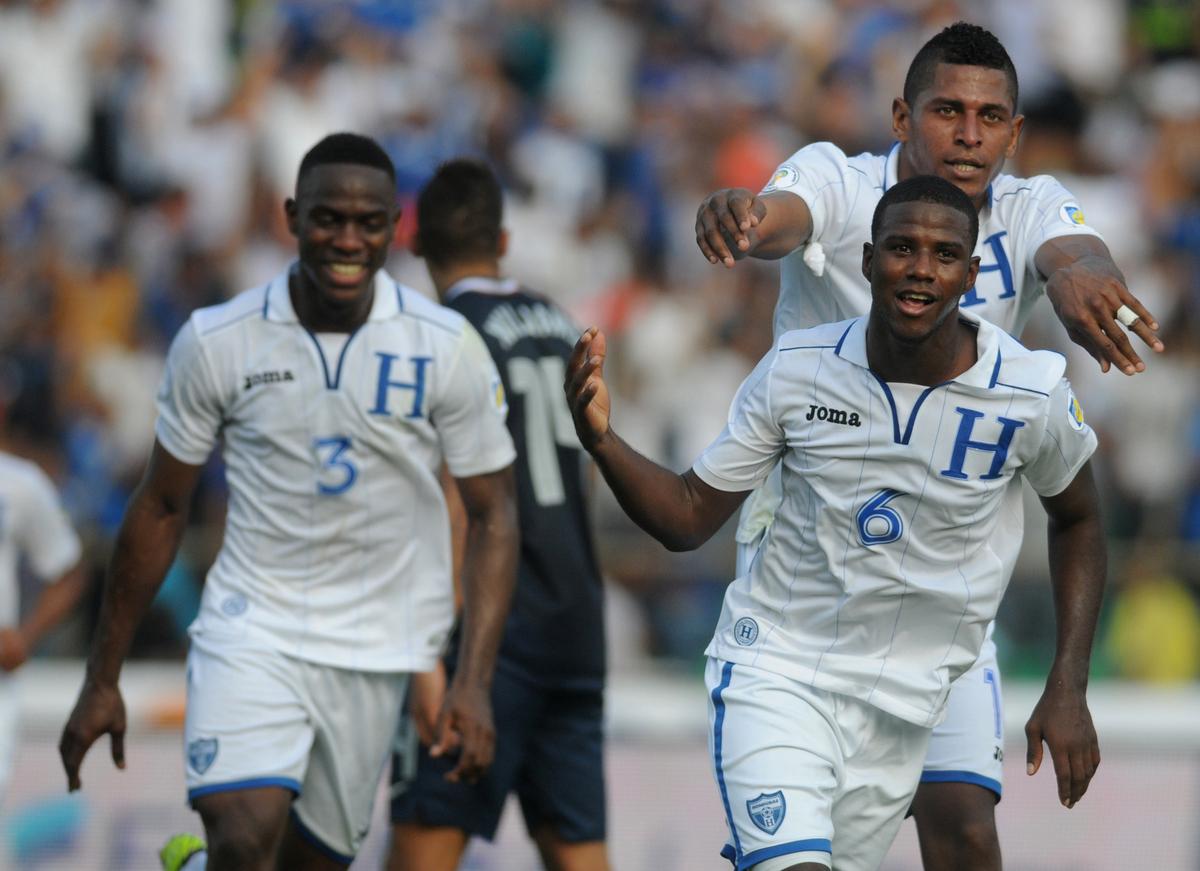 Honduras' Juan Carlos Garcia, front, celebrates followed by teammates after scoring U.S. during a 2014 World Cup qualifying s