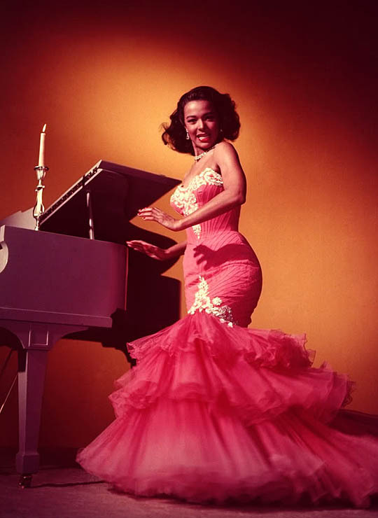 Singer/Actress Dorothy Dandridge posing by a piano. (Photo by Ed Clark//Time Life Pictures/Getty Images)