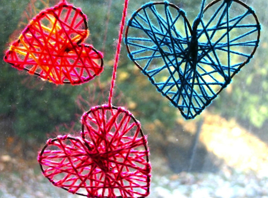 These yarn hearts are like spiderwebs -- but 1,000x sweeter. They'll brighten up any room in the house.