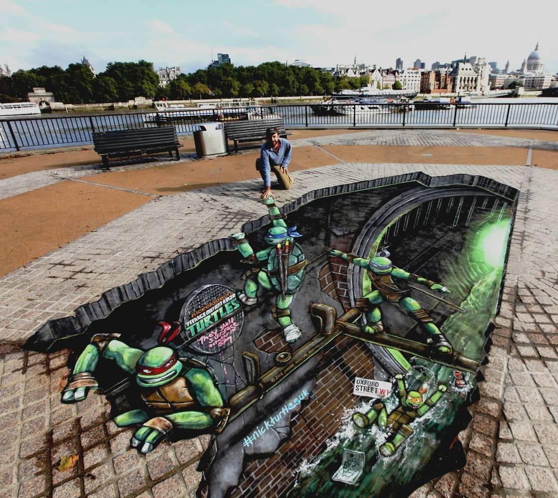 "A <a href=""http://www.reddit.com/r/pics/comments/182451/teenage_mutant_ninja_turtles_3d_street_art/"">photograph </a>of probab"