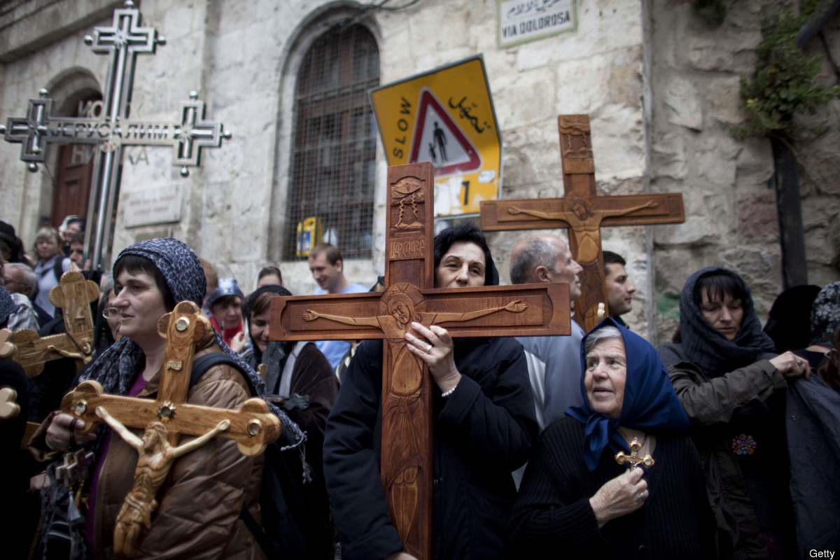 JERUSALEM, ISRAEL - APRIL 22:  (ISRAEL OUT) Chrisitan pilgrims carry wooden crosses along the Via Dolorosa during the Good Fr
