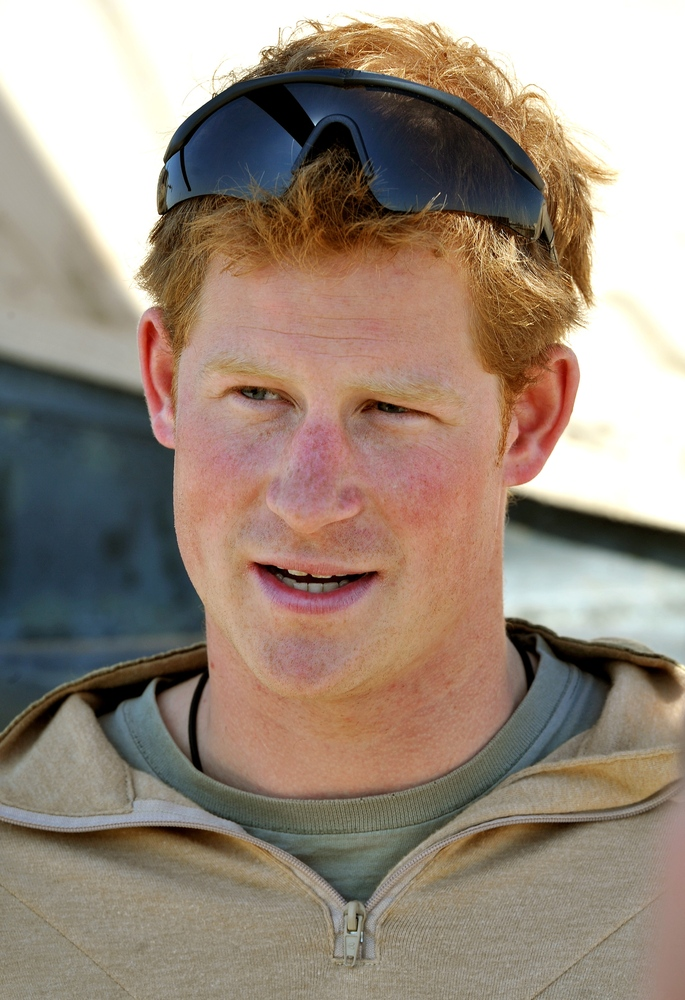 This picture taken on December 2, 2012 shows Britain's Prince Harry giving a TV interview at the British controlled flight-li