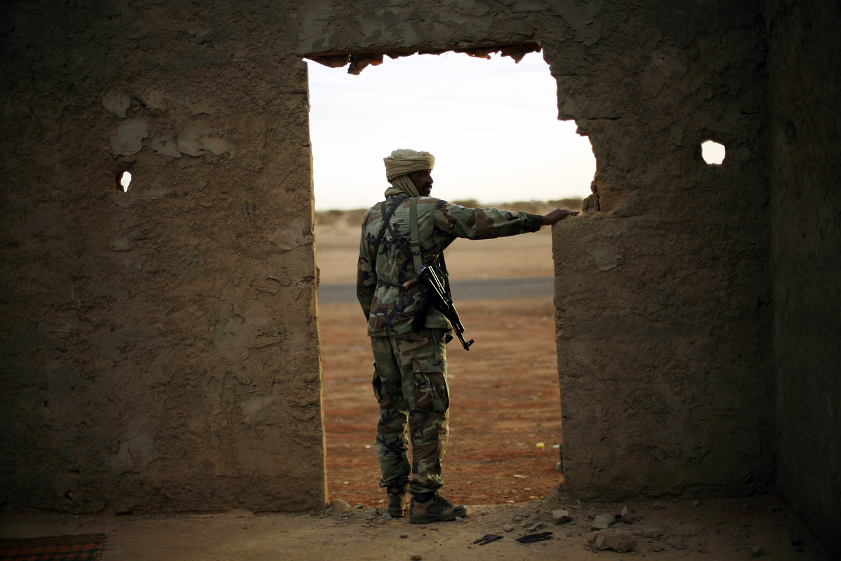 A Tuareg soldier in the Malian army mans a checkpoint at the entrance of Gao, northern Mali, Friday Feb. 8, 2013. (AP Photo/J