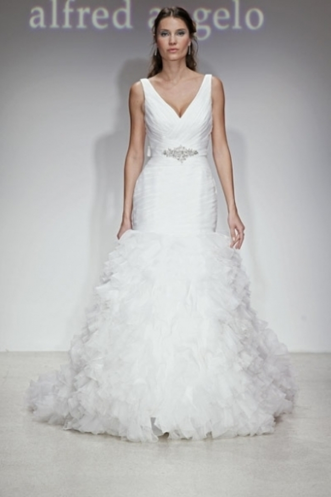 The ruffles and ruched bodice are what caught our eye about this Alfred Angelo gown. The beaded sash is an added bonus!  <a
