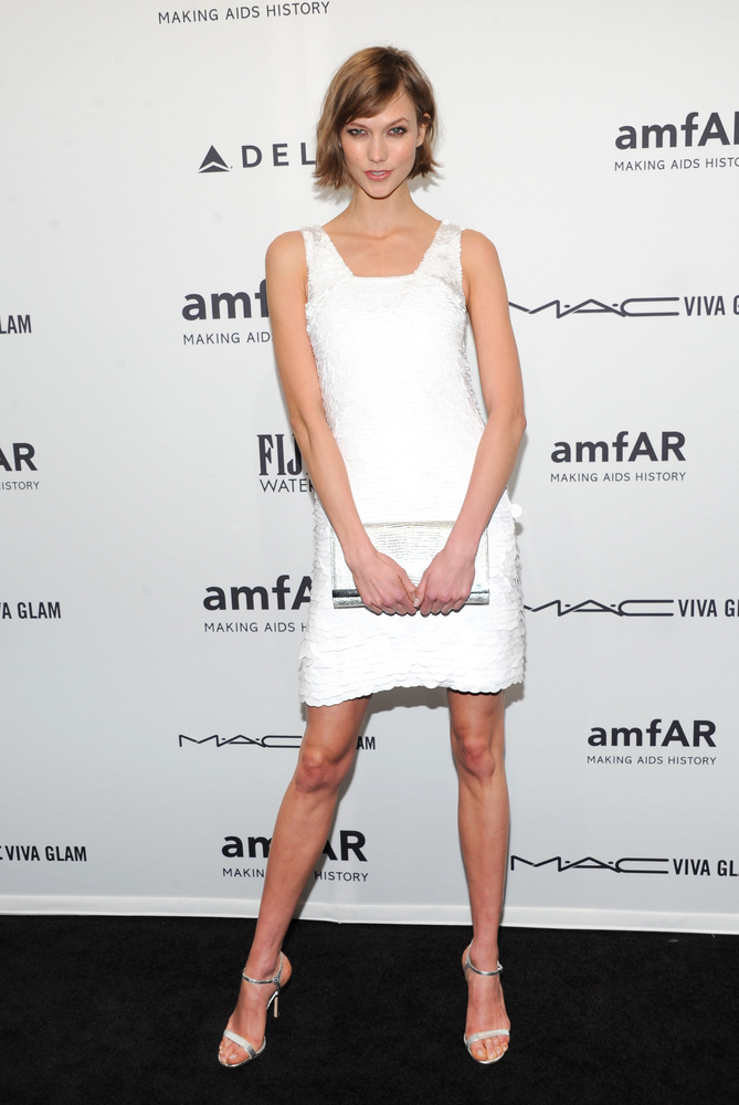 Model Karlie Kloss attends amfAR's New York gala at Cipriani Wall Street on Wednesday, Feb. 6, 2013 in New York. (Photo by Ev