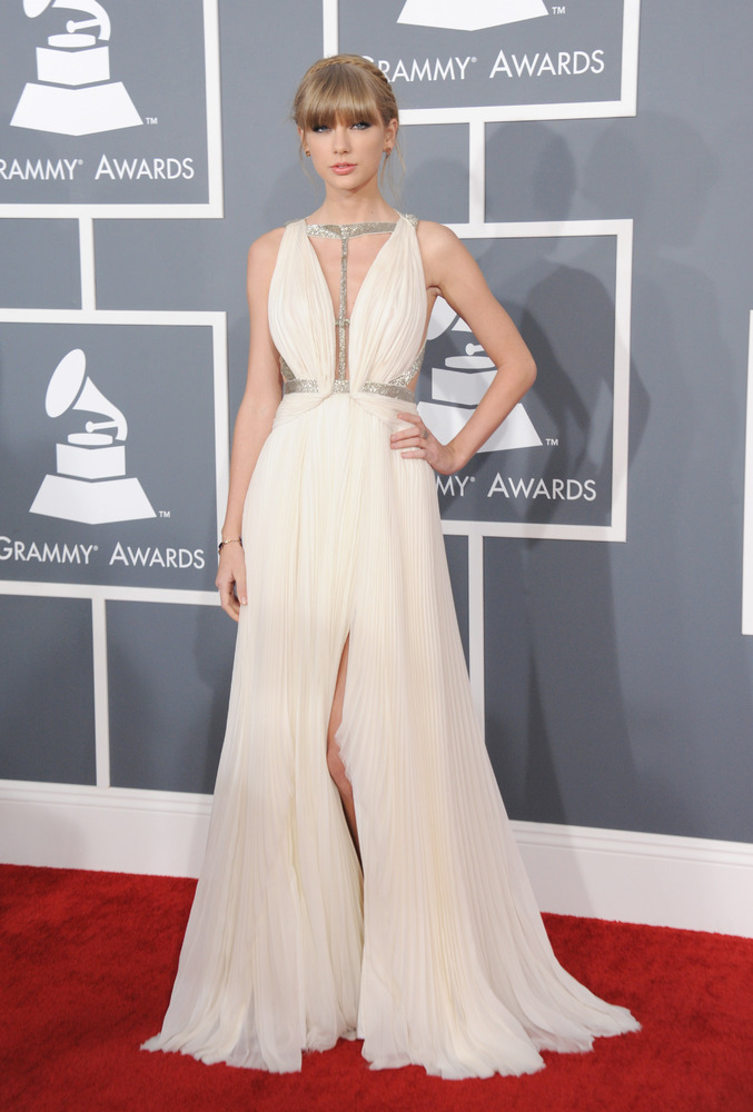 Taylor Swift arrives at the 55th annual Grammy Awards wearing a J. Mendel gown.