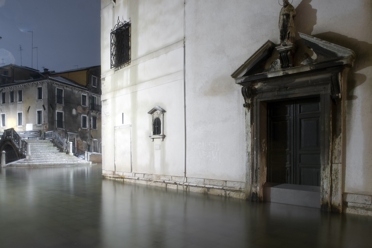 The water rises in a street during an acqua-alta. (MARIT/AFP/Getty Images)