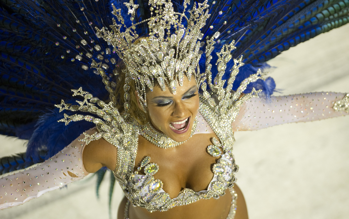 A reveler of Vila Isabel samba school performs during the second night of Carnival parade at the Sambadrome in Rio de Janeiro