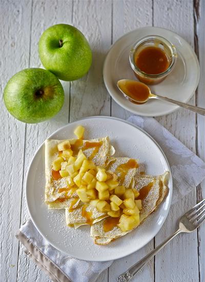 "<strong>Get the <a href=""http://lemonsandanchovies.com/2012/12/caramel-apple-crepes/#.URuipVrwLfl"">Caramel Apple Crepes recip"
