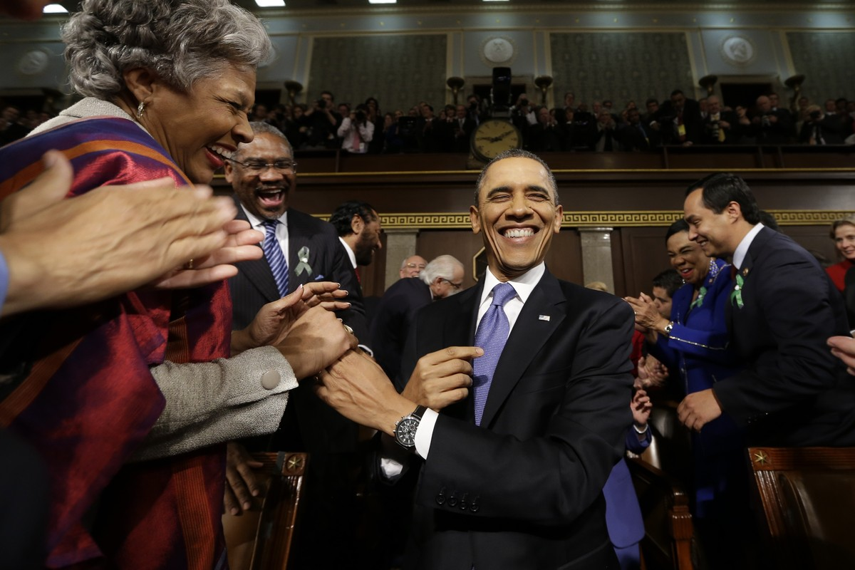 President Barack Obama is greeted before his State of the Union address during a joint session of Congress on Capitol Hill in