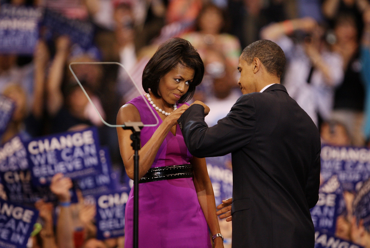 ST. PAUL, MN - JUNE 3:  Democratic presidential candidate Sen. Barack Obama (D-IL) (R) and his wife Michelle Obama bump fists
