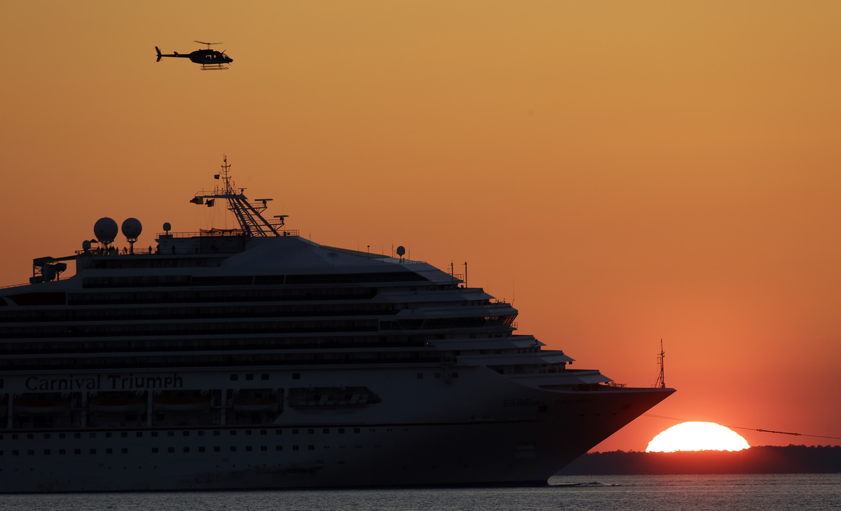The cruise ship Carnival Triumph is towed into Mobile Bay near Dauphin Island, Ala., Thursday, Feb. 14, 2013. The ship with m