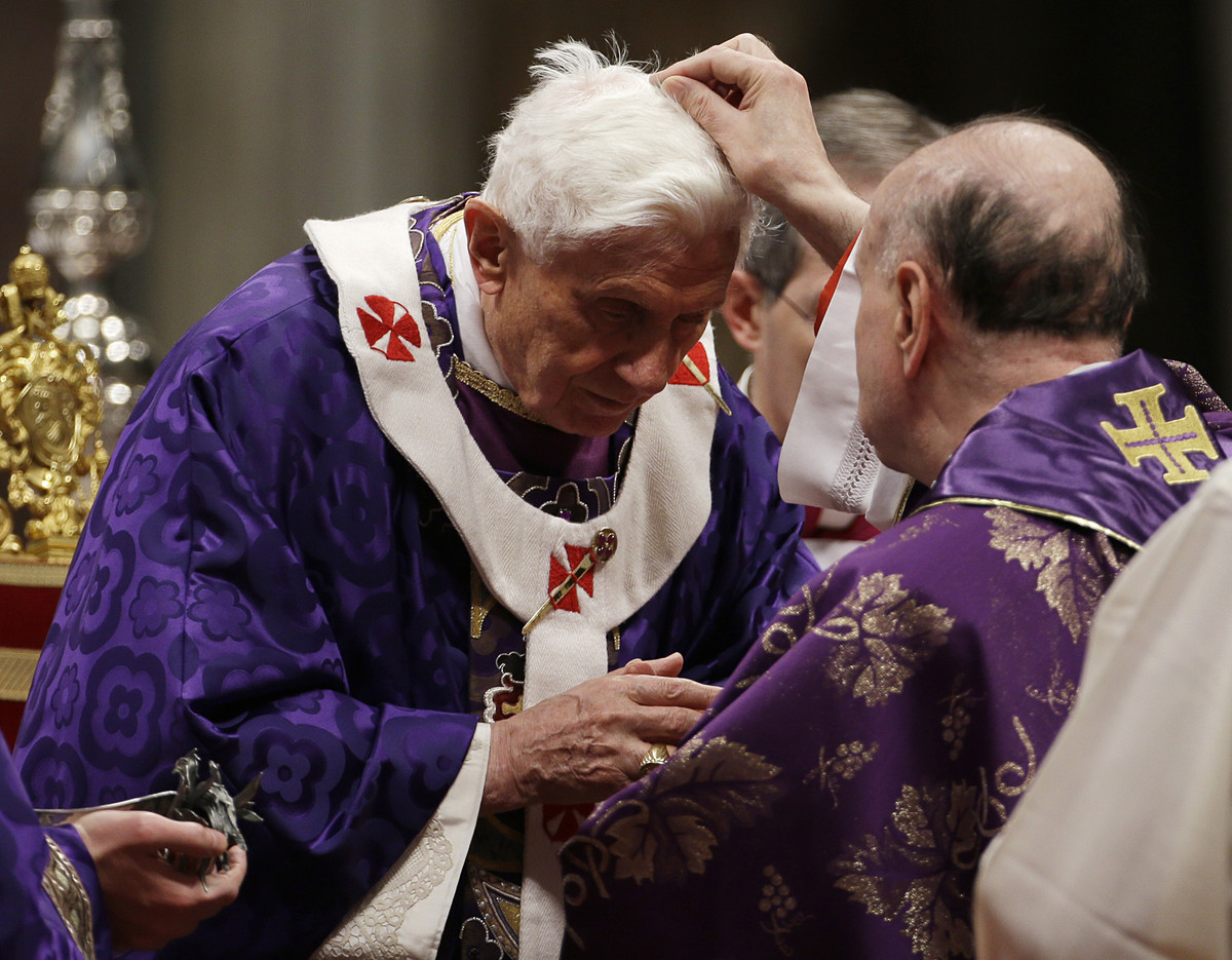 Cardinal Angelo Comastri puts ash on Pope Benedict XVI's head during the celebration of Ash Wednesday mass in St. Peter's Bas