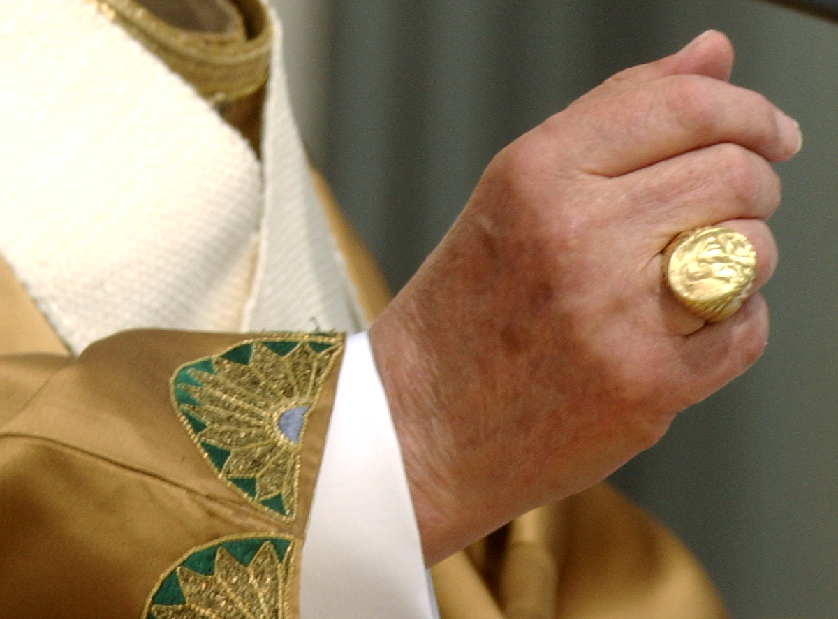 "It is one of the Pope's symbols of ""power."" He placed it on his finger after the election, he removed it every Good Friday du"