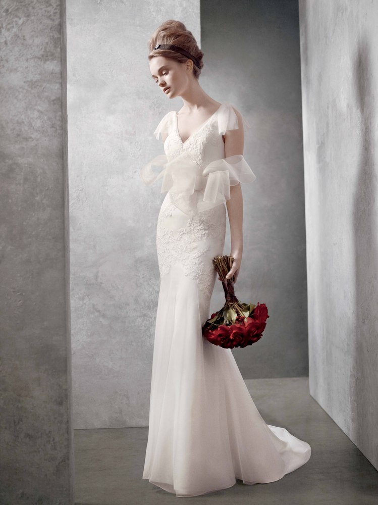 """Soft v-neck gown with hand-appliqued lace. Available at <a href=""""http://www.davidsbridal.com"""">David's Bridal</a>, $800."""