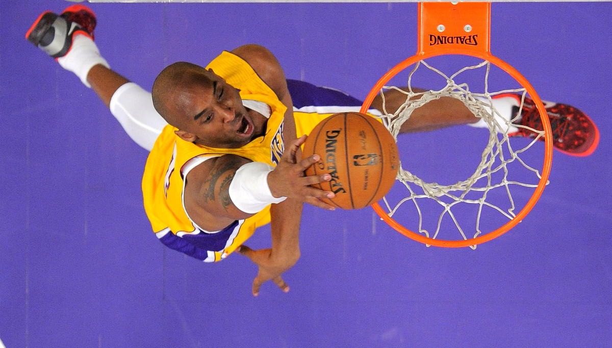 Los Angeles Lakers guard Kobe Bryant goes up for a dunk during the second half of their NBA basketball game against the Los A
