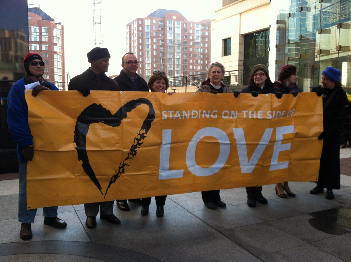 Members of the faith community stand outside the Arlington Courthouse on Valentine's Day 2013 in support of same-sex marriage