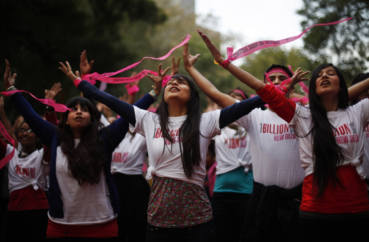 "Activists dance in an event to support ""One Billion Rising"" global campaign in New Delhi, India, Thursday, Feb. 14, 2013. (AP"