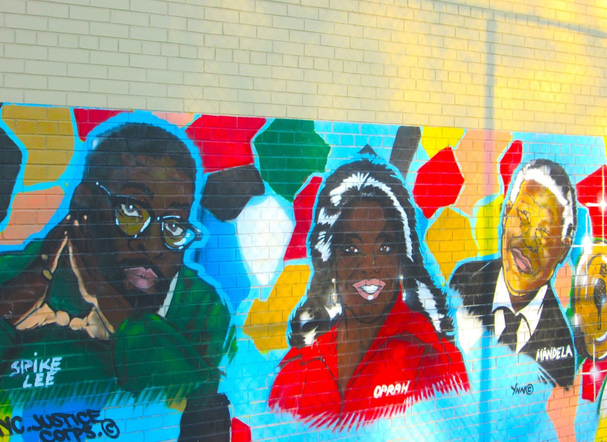 Street art celebrates entertainers such as Spike Lee and Oprah, as well as the political leader Nelson Mandela.
