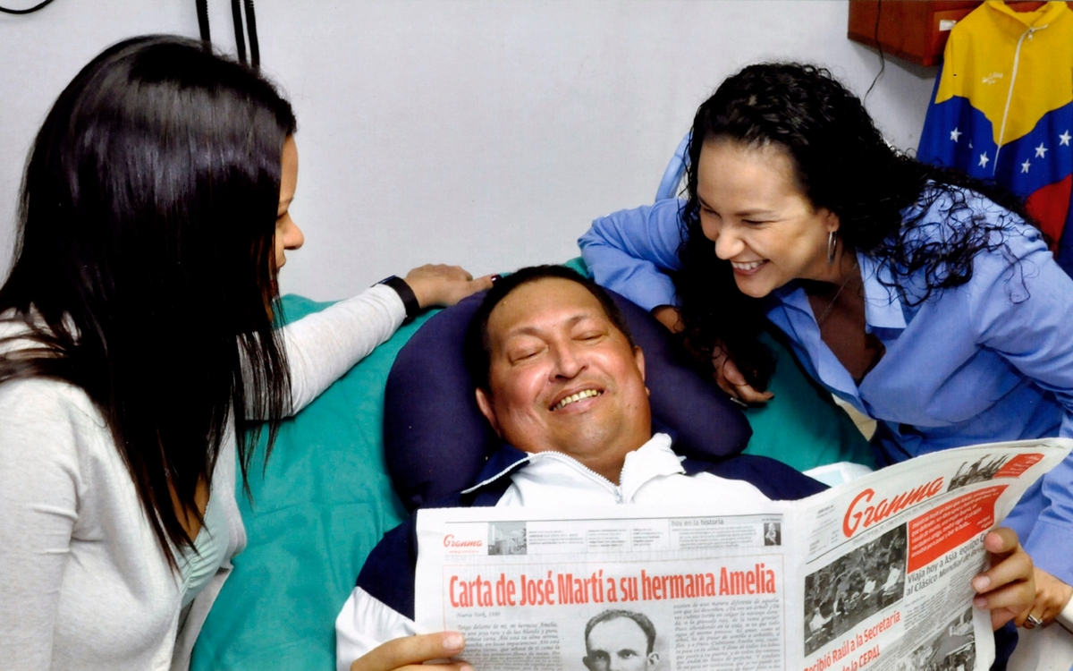 In this photo released Friday, Feb. 15, 2013 by Miraflores Presidential Press Office, Venezuela's President Hugo Chavez, cent