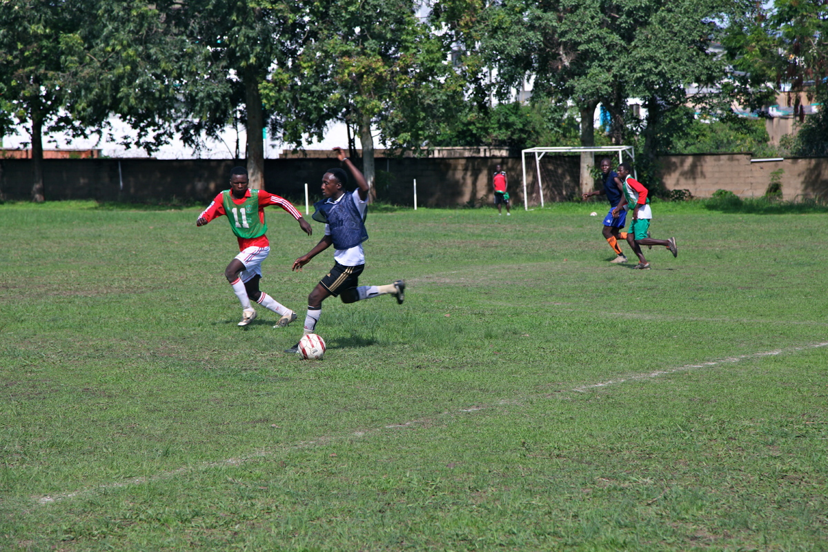 """Young Christian and Muslim men playing in a """"Peace Cup"""" soccer match, a project of Young Ambassadors for Community Peace and"""