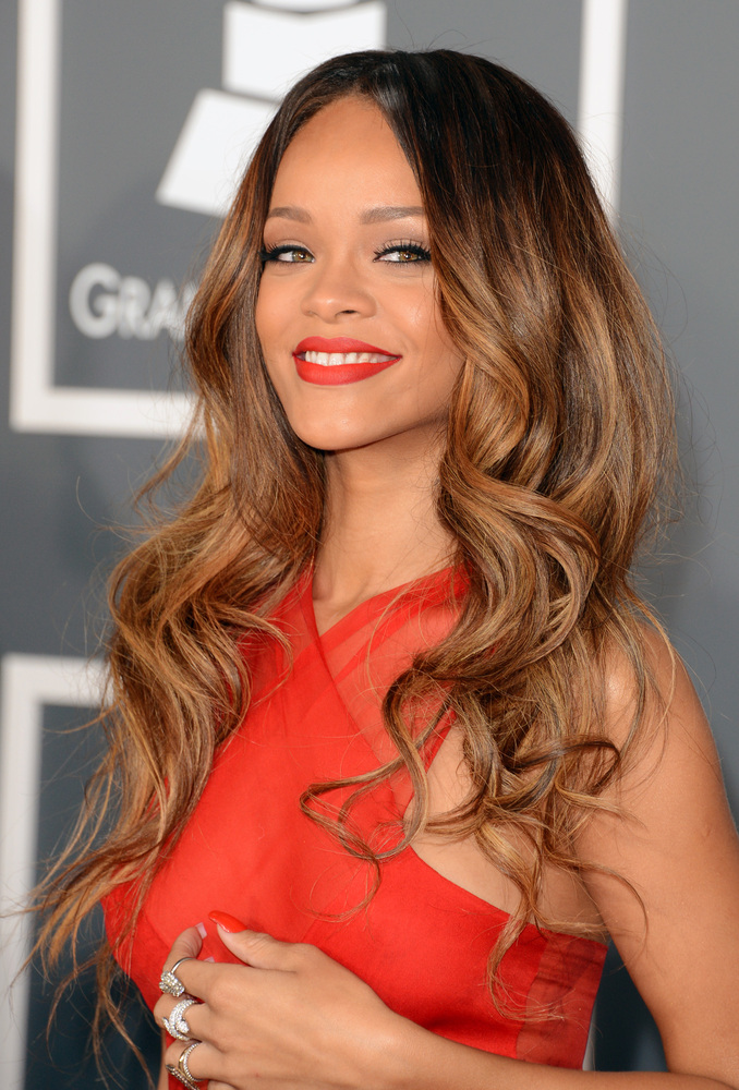 The singer looked radiant at the Grammys this week. We loved her fiery red lip and Botticelli waves.