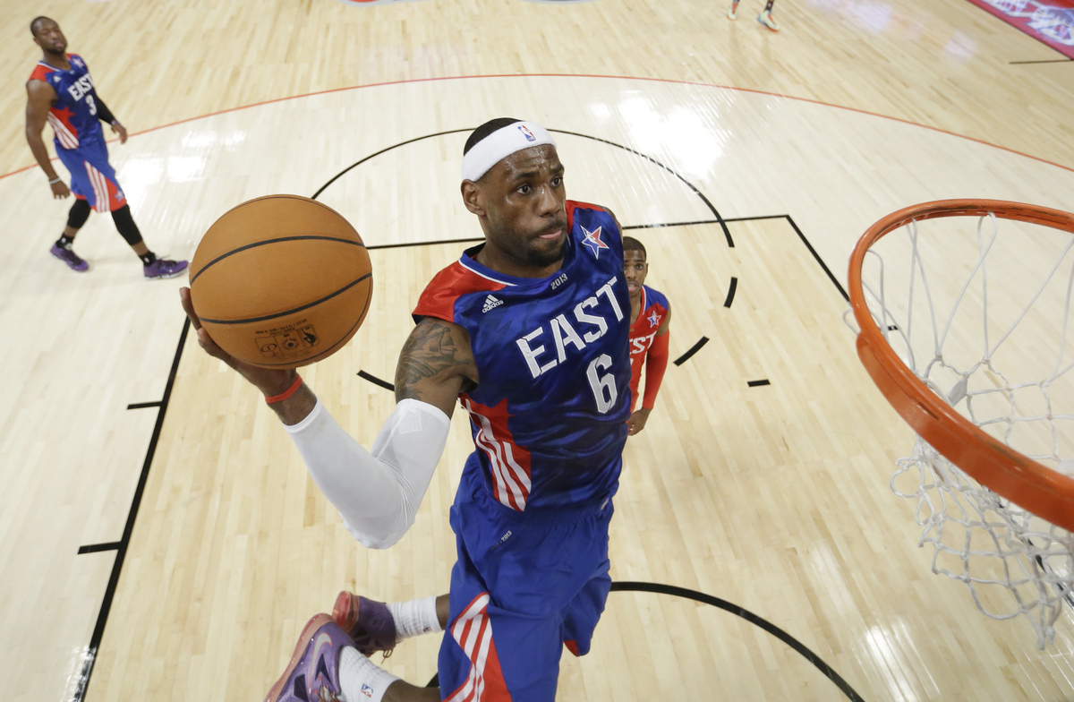 East Team's LeBron James of the Miami Heat goes up for a basket during the first half of the NBA All-Star basketball game Sun