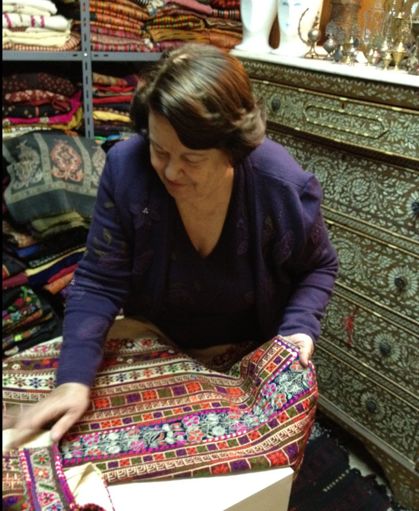 Mrs. Widad Kamel Kawar with her collection