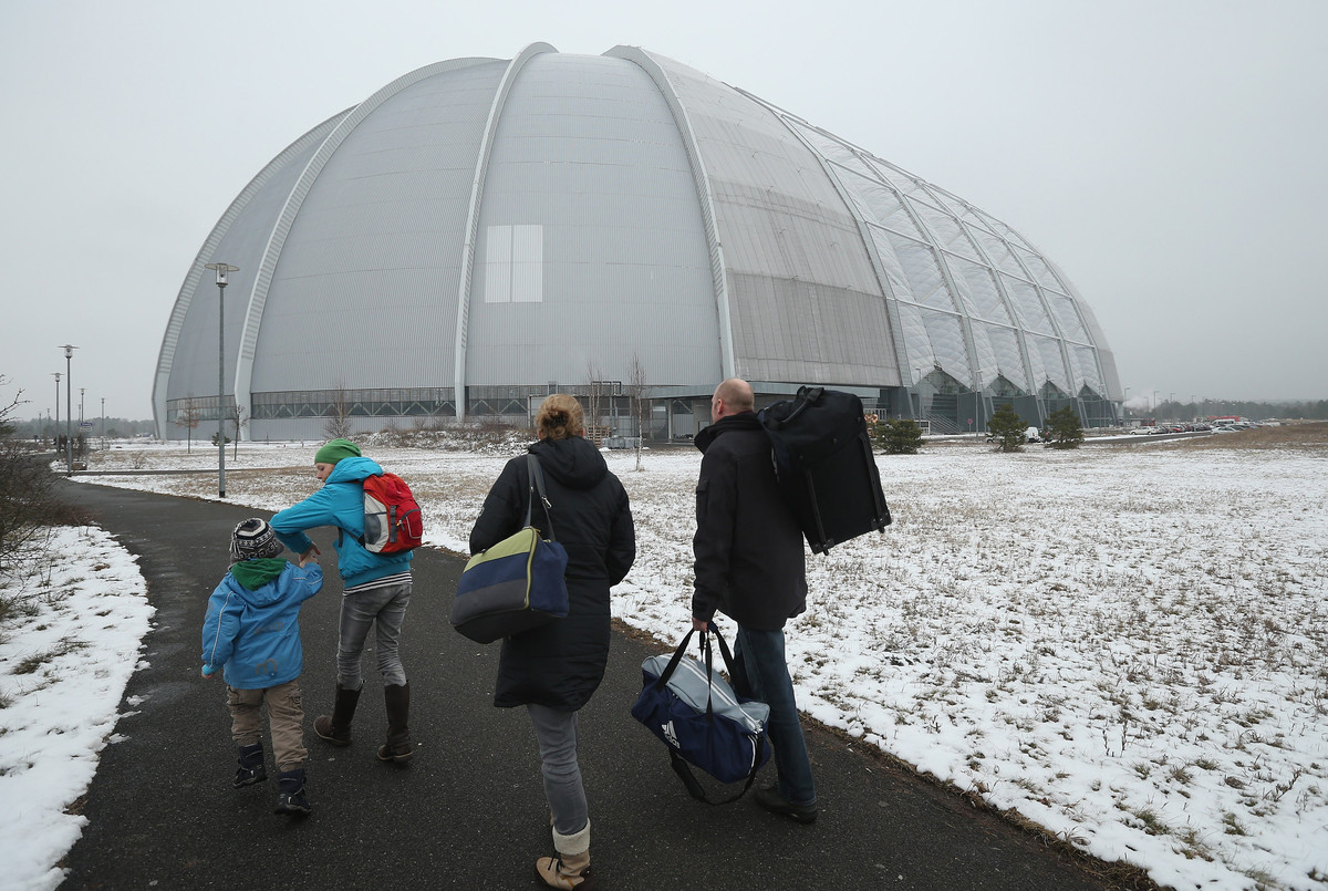Visitors arrive at the giant hangar that houses the Tropical Islands indoor resort on February 15, 2013 in Krausnick, Germany