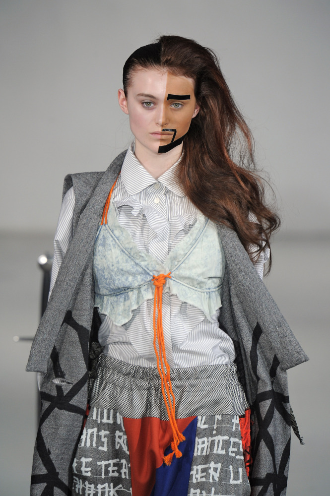 Does it get any more outrageous than this two-faced makeup at Bernhard Willhem? (Catwalking)