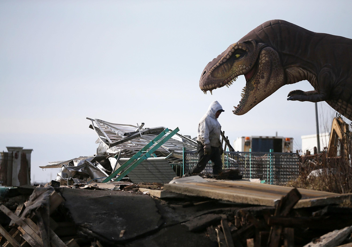 A worker cleans debris from the Fun Town Pier that was damaged by Superstorm Sandy, February 19, 2013 in Seaside Heights, New