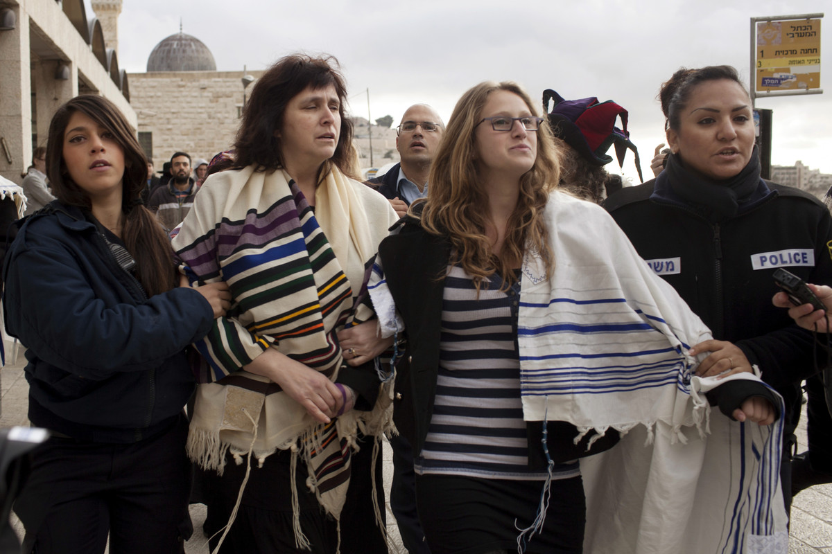 Wrapped in Jewish prayer shawls, Rabbi Susan Silverman, second left, the sister of comedian Sarah Silverman, not seen, along