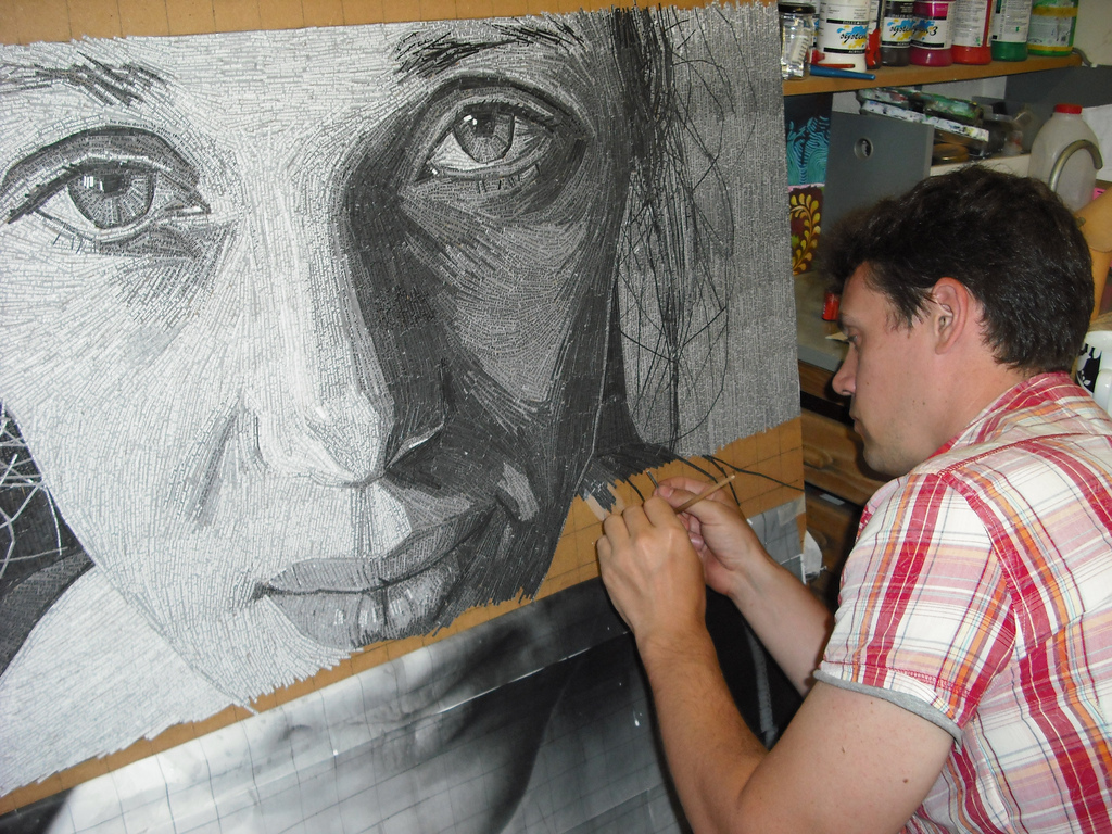 "Artist Jamie Poole works on his ""Sophie"" portrait which is made up of shredded poems. <a href=""www.jamie-poole.com"">See more"