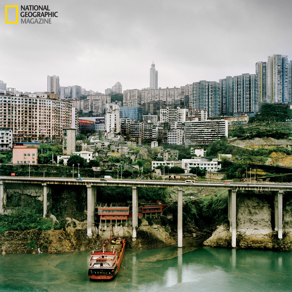New buildings tower over the Wu River. (Anastasia Taylor-Lind/National Geographic)  http://ngm.nationalgeographic.com/2013/03